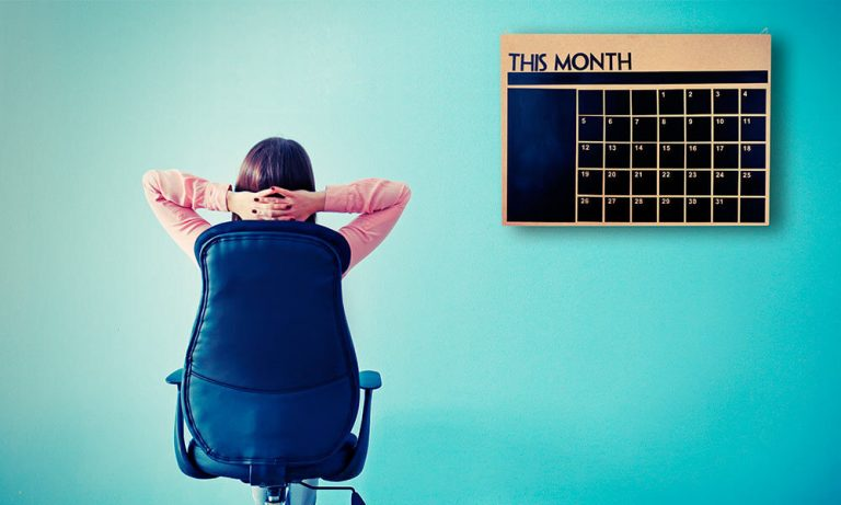 Woman in an office looking at a calendar with an empty schedule